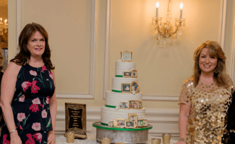 two women with large cake
