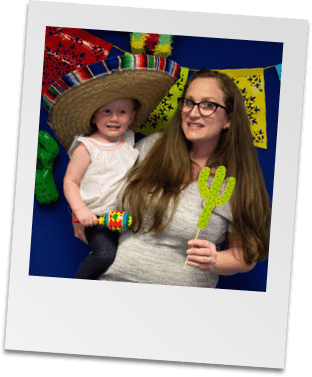 A team member and her child at Cinco de Mayo staff party
