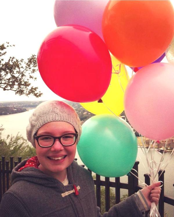 Georgia-holding-balloons