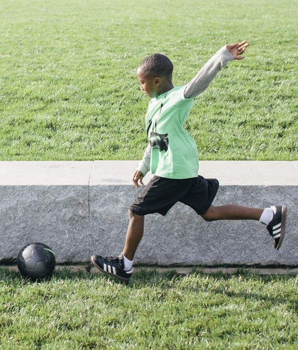 Harlem kicking a soccer ball