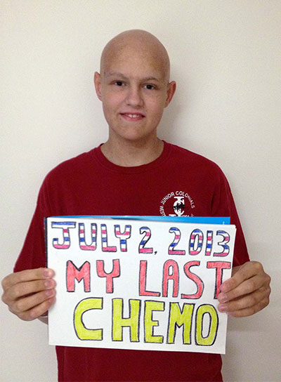 Brian holding a sign commemorating his last day of chemo