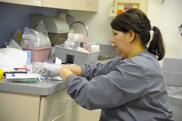 Kelly Clickner preparing pediatric cancer patient samples