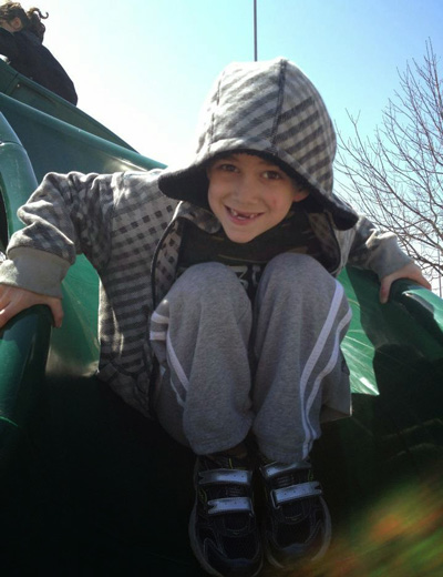 Superman Sam Sommer playing on a playground in April 2012