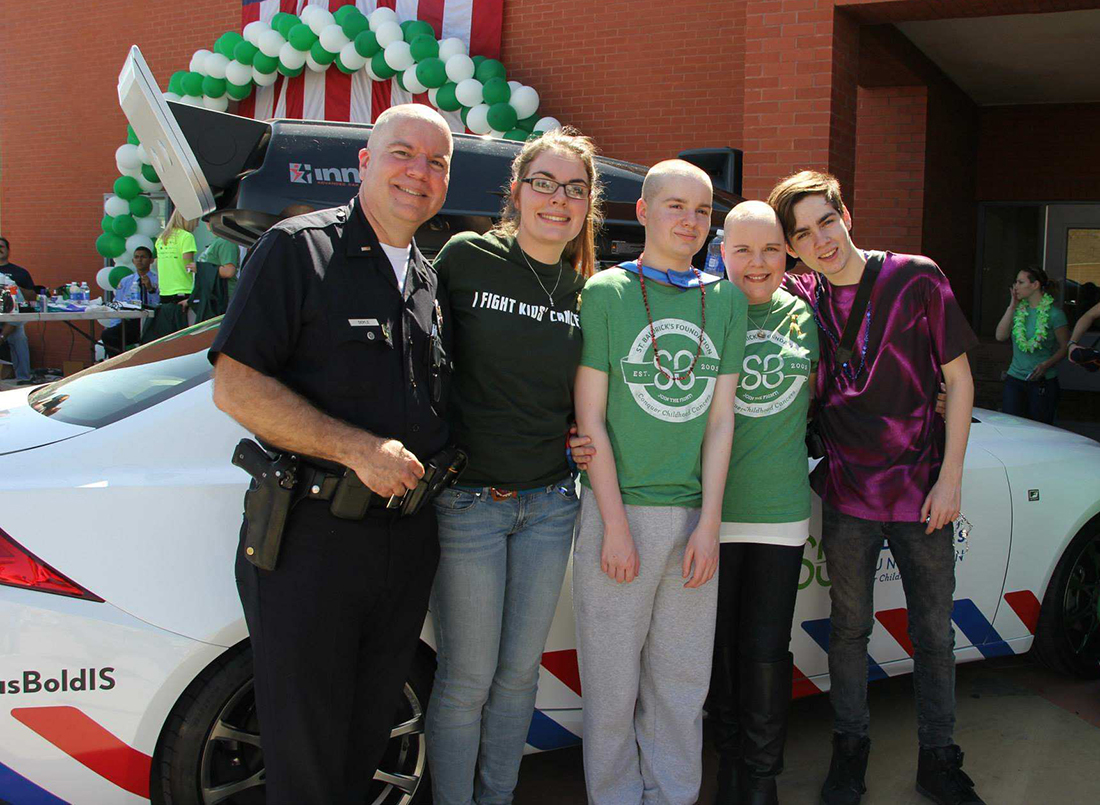 Doyle family in front of St. Baldrick's themed Lexus Bold IS