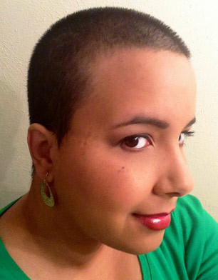 Alyssa after shaving her head to support childhood cancer research