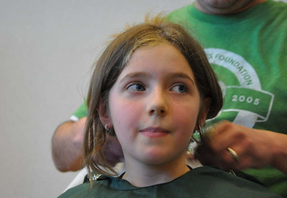 Girl smiles nervously as she prepares to shave