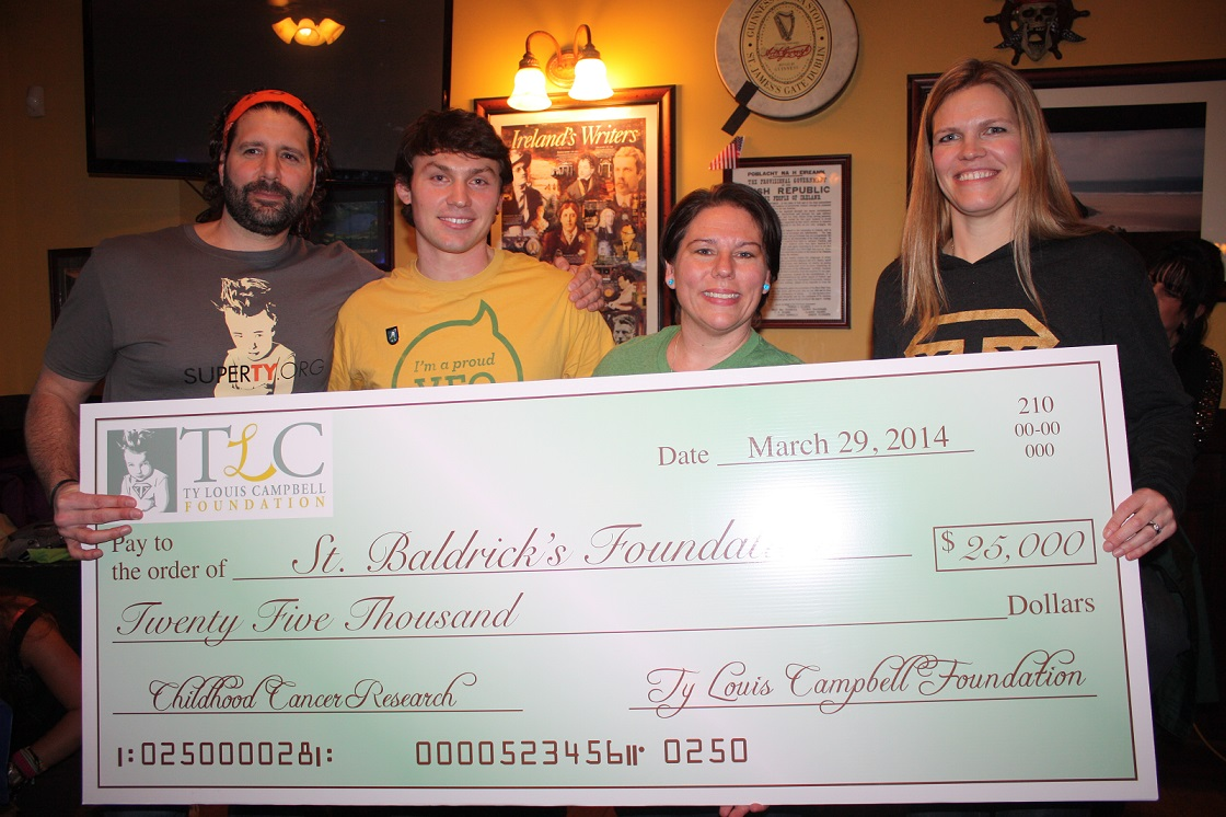 The Ty Louis Campbell Foundation presented a check to the St. Baldrick's Foundation to help fund childhood cancer research
