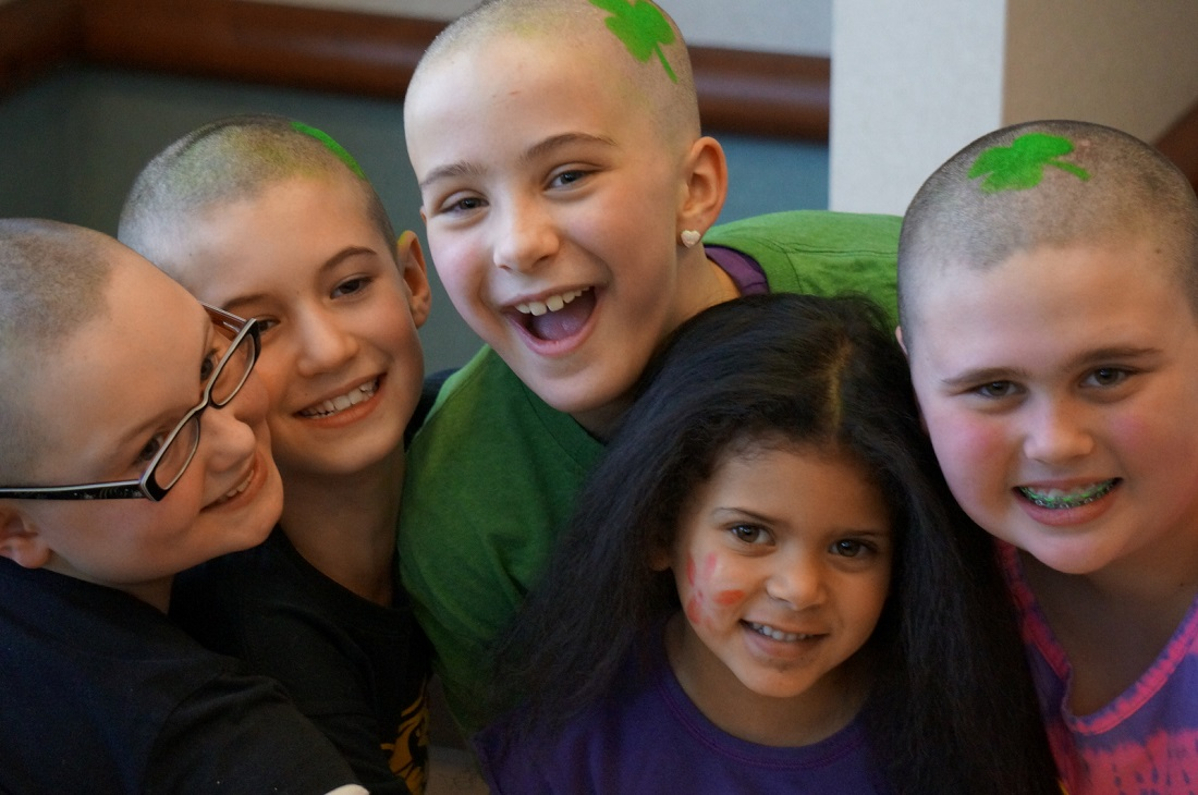 Rebecca with Carolyn and her friends after they shaved their heads for kids with cancer