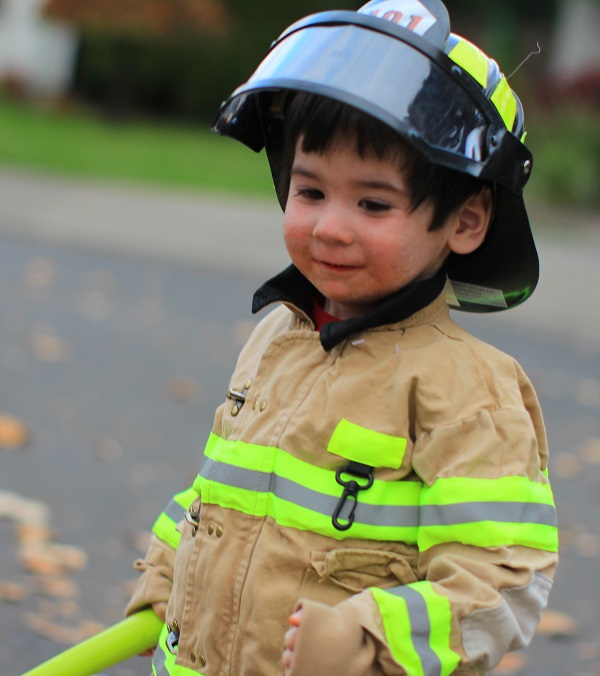 Henry in his fireman costume on Halloween