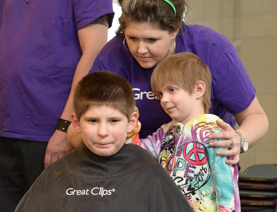 Emily shaved her brother's head for St. Baldrick's