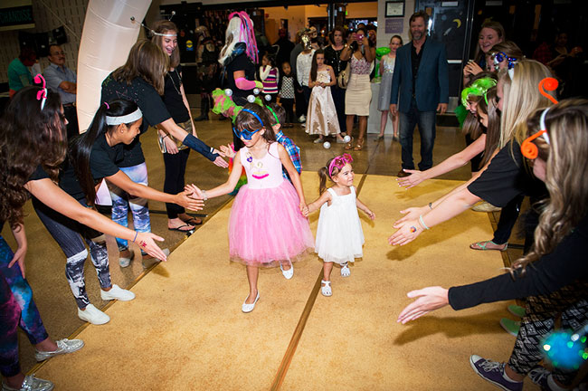 Kids walk the gold carpet at the Miracle Party for families impacted by childhood cancer