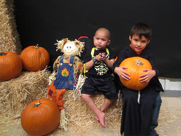 Alan and his brother, Kevin, holding a pumpkin