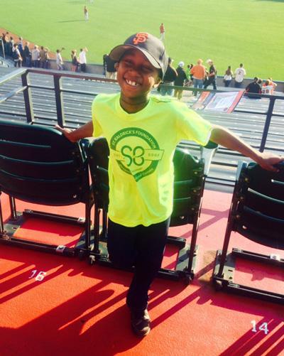 Harlem wears his St. Baldrick's t-shirt at a San Francisco Giants game