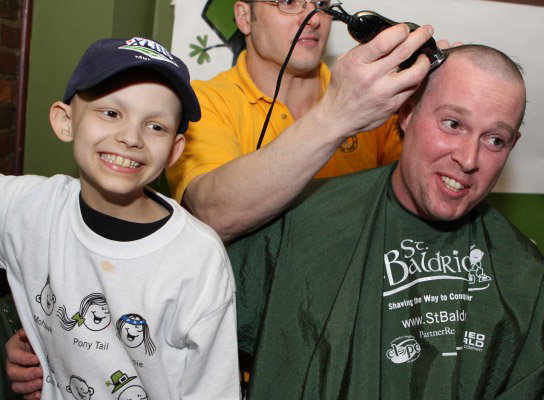 Aiden at a St. Baldrick's head-shaving event in 2009
