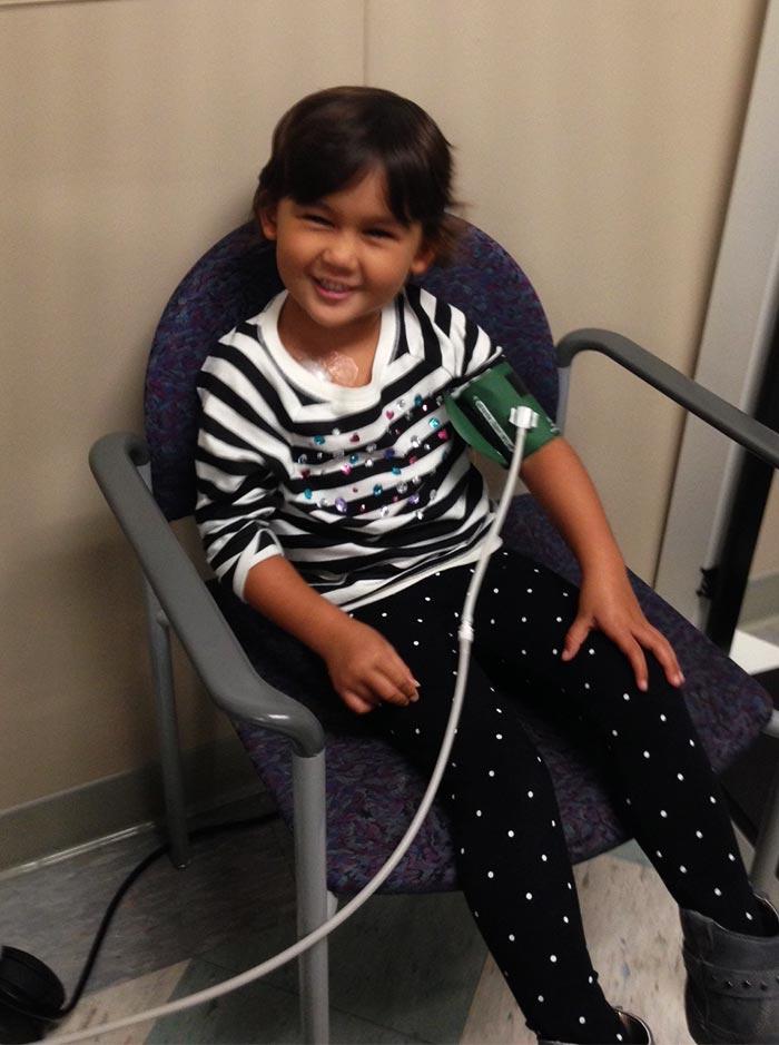 Aubrey getting her blood pressure taken