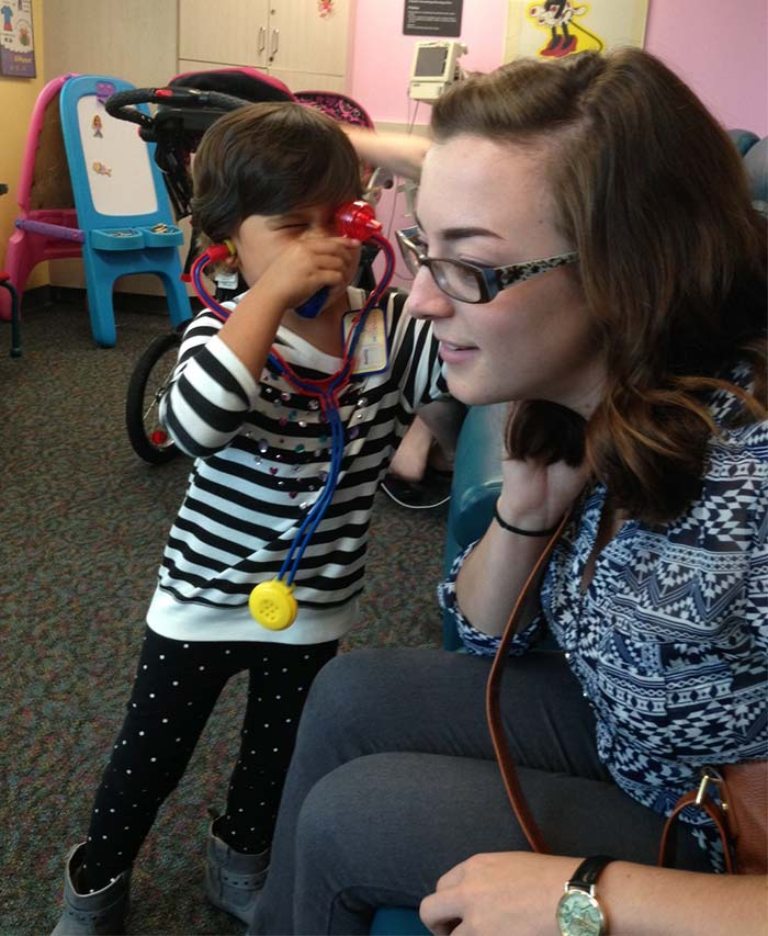 Dr. Aubrey examining Alison
