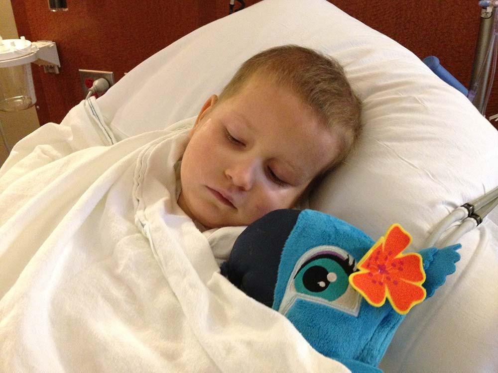 Hannah sleeping after her latest MRI