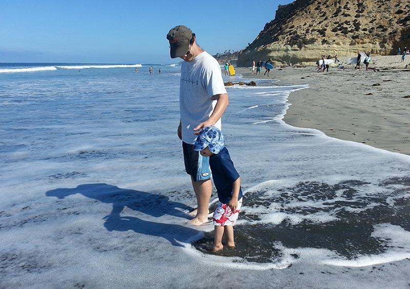 Micah and his dad at the beach