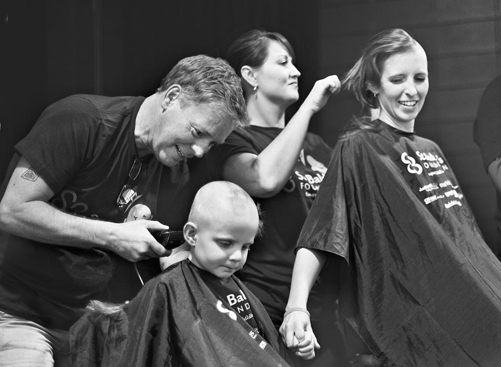 Matthias and Katie shaving heads for cancer