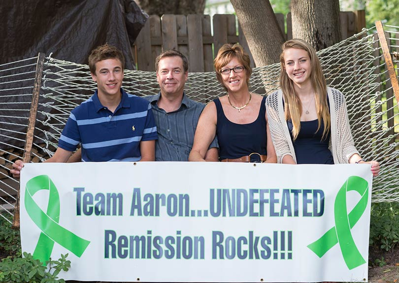 Ambassador Aaron and his family proudly displays a 'Team Aaron' banner.