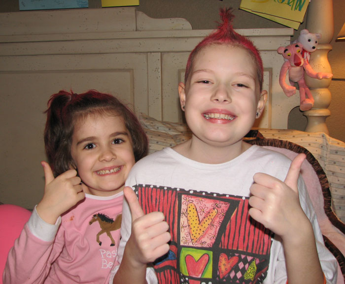 Ivy and Georgia pose together with Georgia's pink mohawk.