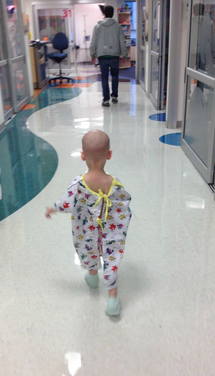 Roxie walks to the playroom at the hospital