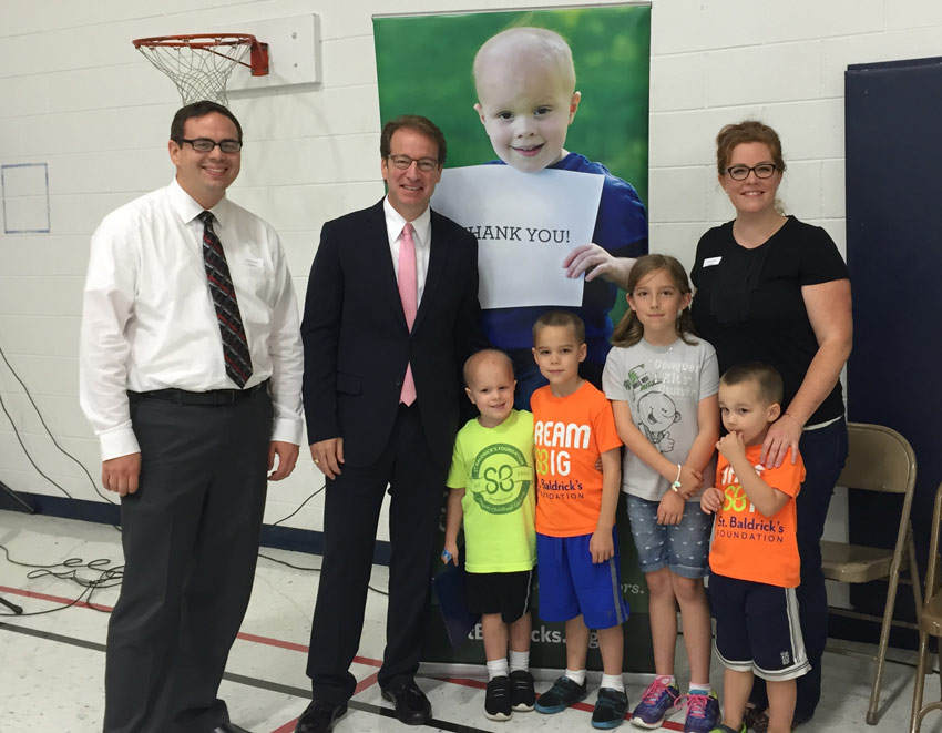 Representative Peter Roskam stands with the Ewoldts