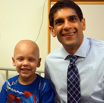 Dr. Rishi Lulla with a childhood cancer patient