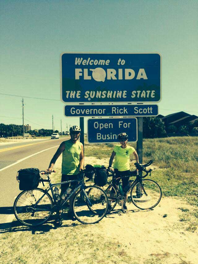 Kim and Jon in front of the Florida sign