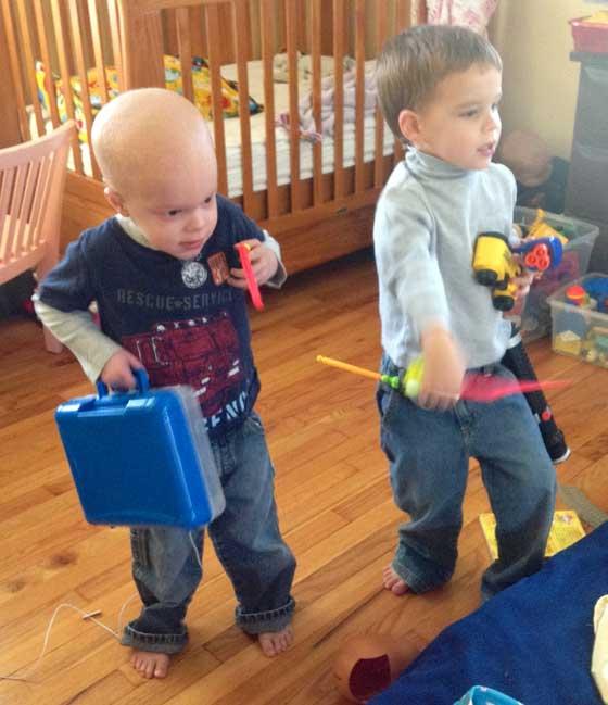 Aidan and Chase play carefully around his IV bag.