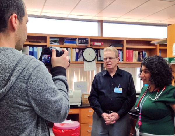Dr. Seeger answers questions for our camera during our visit to his lab
