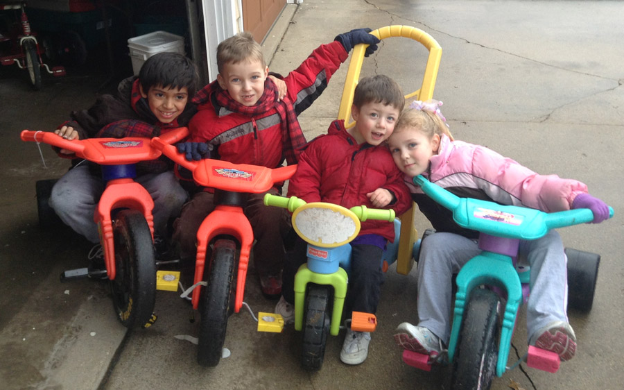 Joseph and his siblings riding bikes