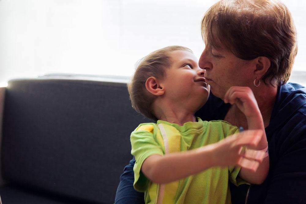 Micah's grandma gives him a kiss