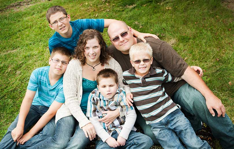 Nicole with her husband and four boys.