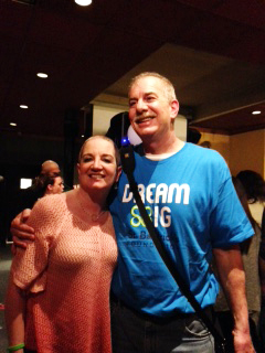 Ginny stands with her husband after their shave with St. Baldrick's.