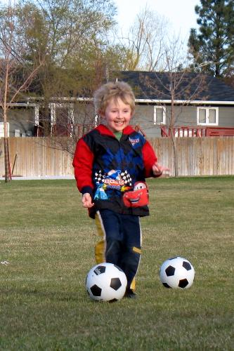 Sam plays soccer before he was diagnosed with cancer.