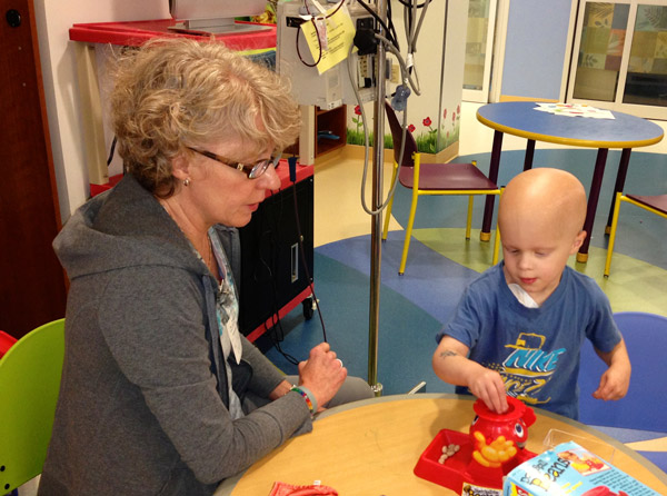 Chase's grandmother plays with Chase in the hospital playroom while he was in treatment for ATRT