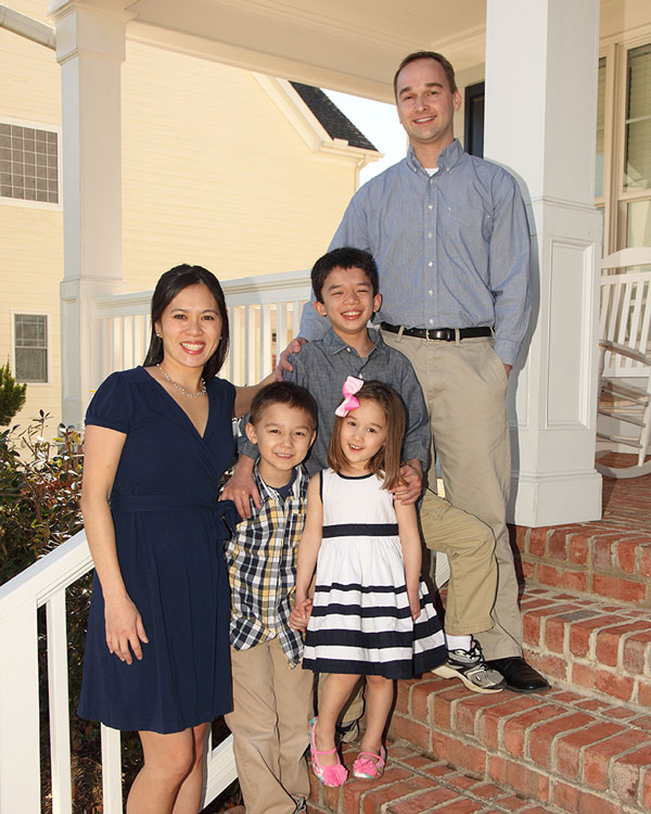 Nancy smiles with her husband and three children