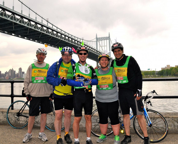 Susan and her cycling friends in front of the Robert F. Kennedy Bridge during the Five Boro Bike Tour.