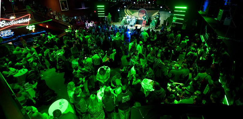 A crowd at a bar during a St. Baldrick's event