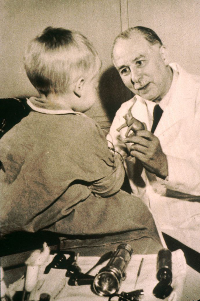 Dr. Sidney Farber meets with a patient