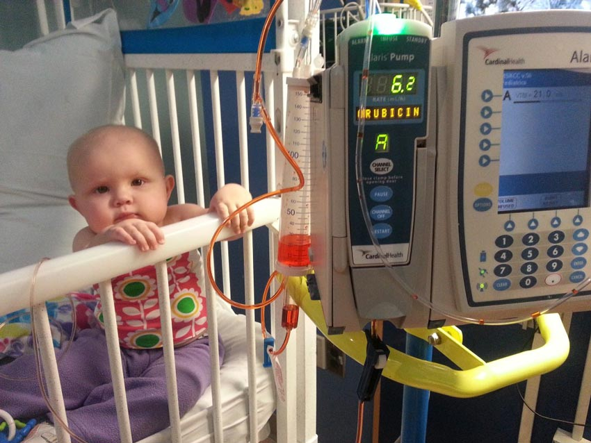 Baby Sally gets chemotherapy in a hospital crib