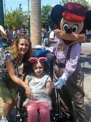 Avery and Stephanie hang out with Mickey Mouse