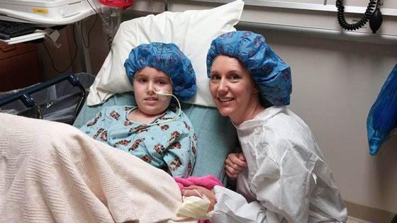 Avery and Stephanie dressed in their scrubs in the hospital