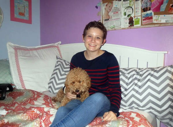 Cierra and her dog in her room