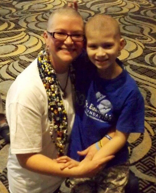Kristi and Julian hug each other after they both shaved for St. Baldrick's