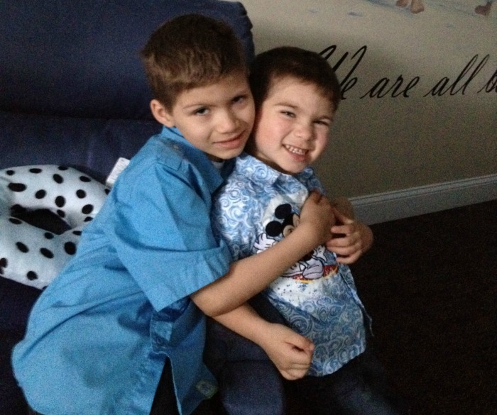Julian and Brayden hug each other