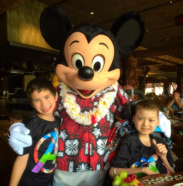 Brayden and Julian hang out with Mickey Mouse during Julian's Disney trip