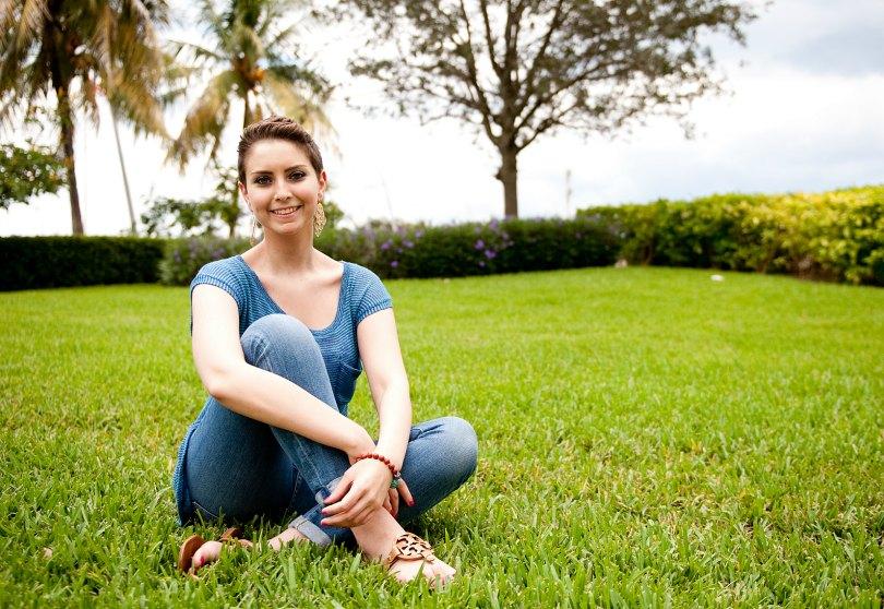 Ambassador Lauren sits in the grass