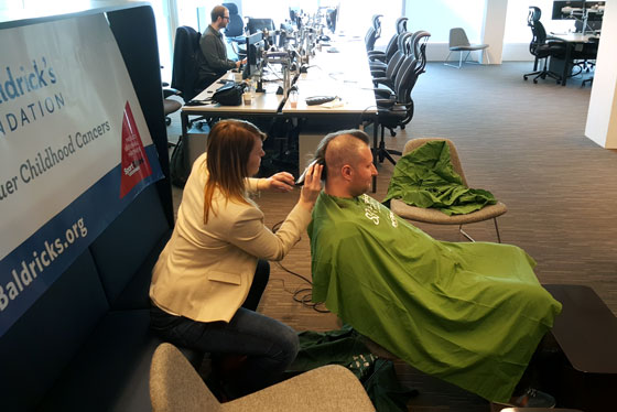 Barber shaves head in Amsterdam